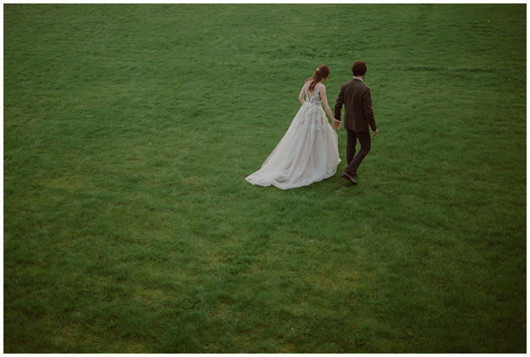 bride-groom-walking-grass